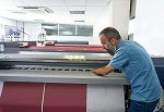 Man using a large format printer